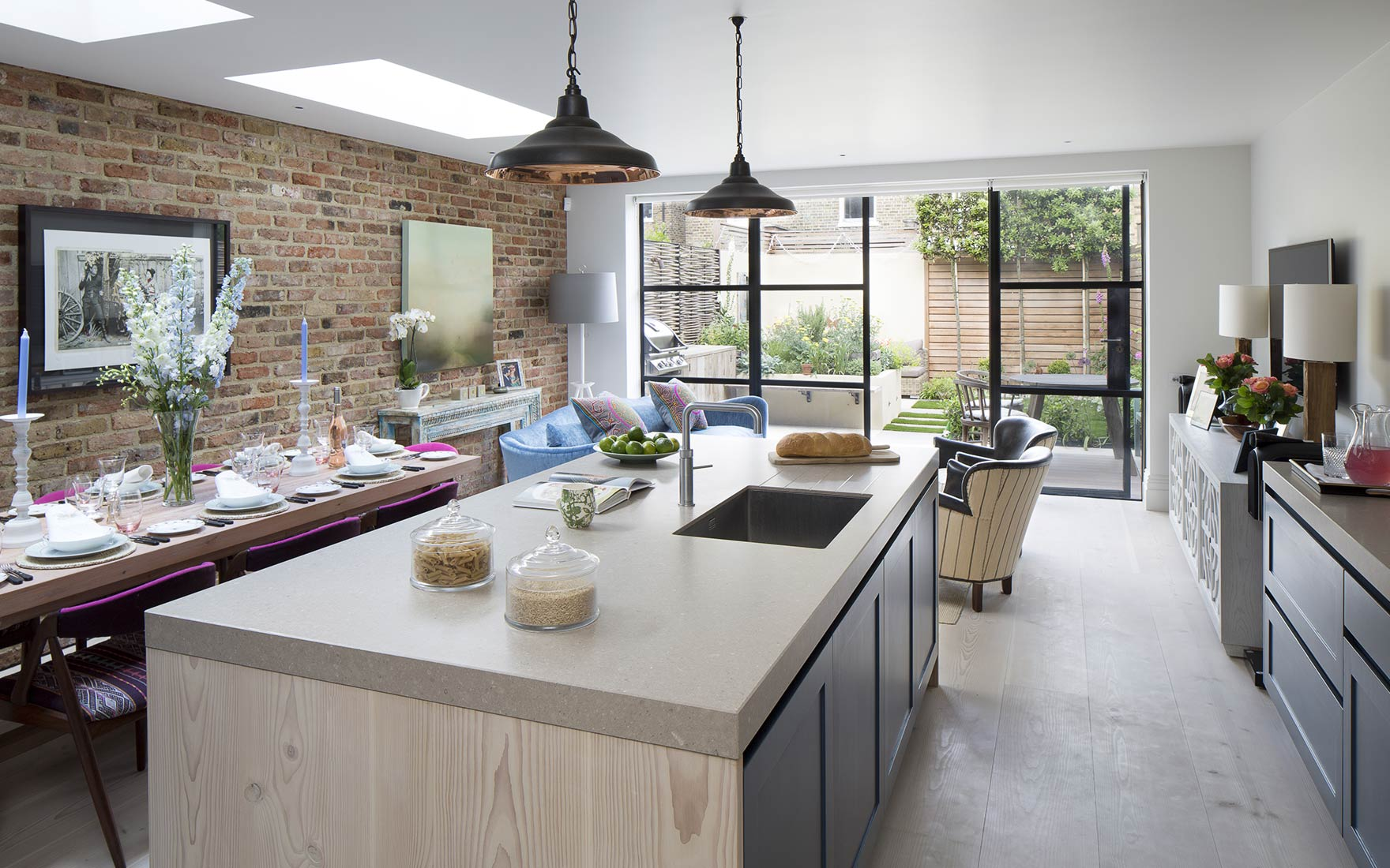 Wandsworth kitchen dining area with exposed brick wall and concrete work surface